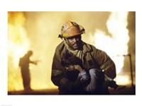 Firefighter carrying a boy Fine-Art Print