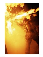 Fireman fighting with fire flames Fine-Art Print