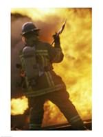 Rear view of a firefighter holding an axe Fine-Art Print
