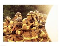Group of firefighters spraying water with a fire hose Fine-Art Print