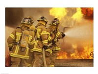 Rear view of a group of firefighters extinguishing a fire and flames Fine-Art Print