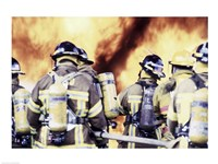 Rear view of a group of firefighters holding water hoses Fine-Art Print