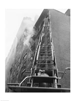 Fire engine with ladder up burning building Fine-Art Print