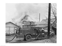 Fire engine next to home in fire Fine-Art Print