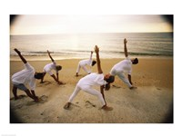 Group of people performing yoga on the beach Fine-Art Print