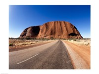 Road passing through a landscape, Ayers Rock, Uluru-Kata Tjuta National Park, Australia Fine-Art Print
