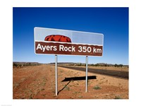 Distance sign on the road side, Ayers Rock, Uluru-Kata Tjuta National Park, Australia Fine-Art Print