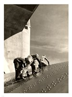 Three construction workers putting a coat of paint on a slanted wall of riveted-steel plates on the Hoover Dam spillway Fine-Art Print