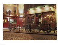 Bicycles parked in front of a restaurant at night, Dublin, Ireland Fine-Art Print