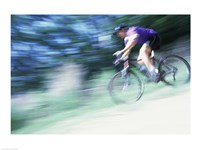Side profile of a young man riding a bicycle Fine-Art Print