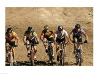 Group of people riding bicycles in a race Fine-Art Print