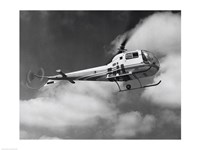 Low angle view of a helicopter in flight in the sky, Bell Helicopter Fine-Art Print