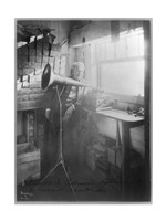 Thomas Alva Edison, full-length portrait, standing, facing right, listening to a new record Fine-Art Print