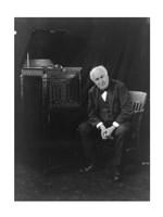 Thomas Edison, seated beside phonograph Fine-Art Print