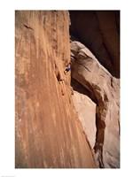 Low angle view of a man climbing a mountain, Utah, USA Fine-Art Print