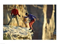 Two hikers with ropes at the edge of a cliff Fine-Art Print