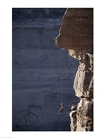 Man hanging from a rope on the edge of a cliff Fine-Art Print