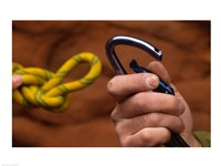 Close-up of human hands holding a carabiner and rope Fine-Art Print