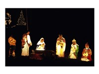 Figurines depicting nativity scene lit up at night Fine-Art Print