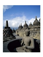Buddha statue in front of a temple, Borobudur Temple, Java, Indonesia Fine-Art Print