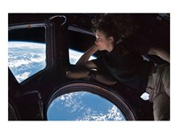 Tracy Caldwell Dyson in the Cupola Observing the Earth during Expedition 24 Fine-Art Print