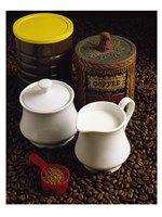 Close-up of a mug of milk with a measuring spoon and jars on coffee beans Fine-Art Print