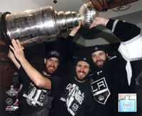 Jeff Carter, Mike Richards, & Dustin Penner with the Stanley Cup Trophy after Winning Game 6 of the 2012 Stanley Cup Finals Fine-Art Print