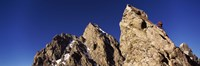 Low angle view of a man climbing up a mountain, Rockchuck Peak, Grand Teton National Park, Wyoming, USA Fine-Art Print