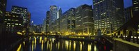 Low angle view of buildings lit up at night, Chicago River, Chicago, Illinois, USA Fine-Art Print