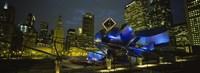 Low angle view of buildings lit up at night, Pritzker Pavilion, Millennium Park, Chicago, Illinois, USA Fine-Art Print