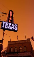 Low angle view of a neon sign of a hotel lit up at dusk, Fort Worth Stockyards, Fort Worth, Texas, USA Fine-Art Print