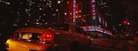 Car on a road, Radio City Music Hall, Rockefeller Center, Manhattan, New York City, New York State, USA Fine-Art Print