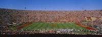 High angle view of a football stadium full of spectators, Los Angeles Memorial Coliseum, City of Los Angeles, California, USA Fine-Art Print