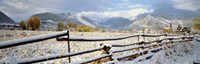 Wooden fence covered with snow at the countryside, Colorado, USA Fine-Art Print