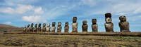 Low angle view of Moai statues in a row, Easter Island, Chile Fine-Art Print