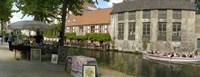 Flea market at a canal, Dijver Canal, Bruges, West Flanders, Belgium Fine-Art Print