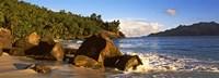 Waves splashing onto rocks on North Island with Silhouette Island in the background, Seychelles Fine-Art Print