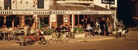 Tourists sitting in a cafe, Sitges Beach, Catalonia, Spain Fine-Art Print