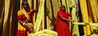 Portrait of two mature women working in a textile industry, Rajasthan, India Fine-Art Print