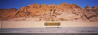 Bench in front of rocks, Red Rock Canyon State Park, Nevada, USA Fine-Art Print