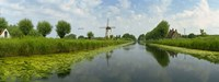 Traditional windmill along with a canal, Damme, Belgium Fine-Art Print