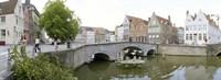Bridge across a channel, Bruges, West Flanders, Belgium Fine-Art Print