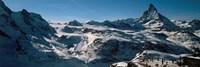 Skiers on mountains in winter, Matterhorn, Switzerland Fine-Art Print