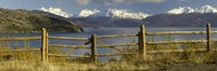 Fence in front of a lake with mountains in the background, Lake General Carrera, Andes, Patagonia, Chile Fine-Art Print