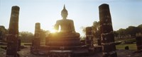 Statue of Buddha at sunset, Sukhothai Historical Park, Sukhothai, Thailand Fine-Art Print