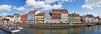 Tourists in a tourboat with buildings along a canal, Nyhavn, Copenhagen, Denmark Fine-Art Print