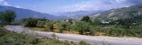 Road passing through a landscape with mountains in the background, Andalucian Sierra Nevada, Andalusia, Spain Fine-Art Print