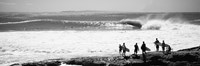 Silhouette of surfers standing on the beach, Australia (black and white) Fine-Art Print