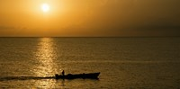 Fishing boat in the sea at sunset, Negril, Westmoreland, Jamaica Fine-Art Print