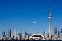 Airplane over city skylines, CN Tower, Toronto, Ontario, Canada 2011 Fine-Art Print